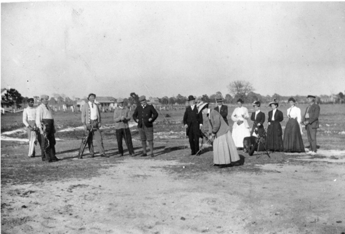 Center, in plus fours, on the teeing ground, Sarasota c. 1905.